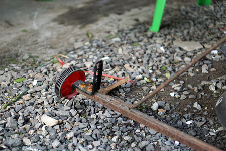 Closeup old wheel of trolly on the rock floor Stock Photo - 91342650
