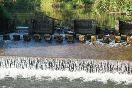 Human made Weir at Amphoe Thong Pha Phum, Mueang Kanchanaburi Thailand.  Use to slow down the flow of water from the dam.