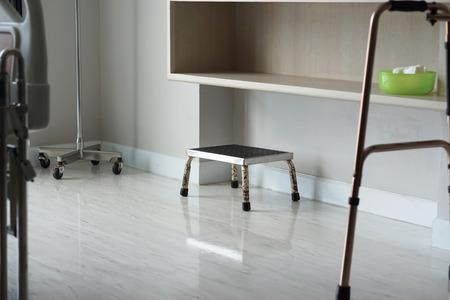 Small metal step stool on the floor of hospital