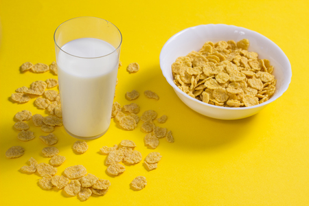 Corn flakes with milk on a yellow background Stok Fotoğraf