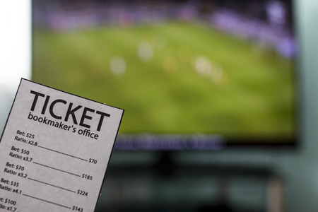 hands of a ticket office bookmaker, sports betting, close-ups, Champions League 스톡 콘텐츠