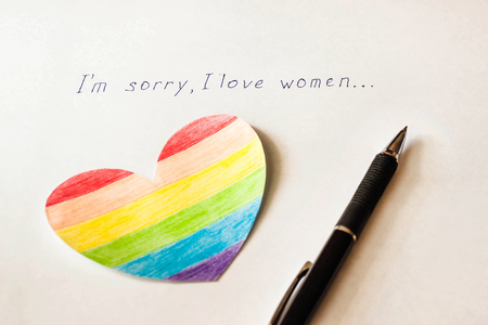 Inscription on white background I'm sorry I love women, heart in the form of a flag LGBT and a pen, lesbian and bisexual Foto de archivo