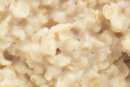 Boiled oat porridge, macro photography, bunting and childrens food