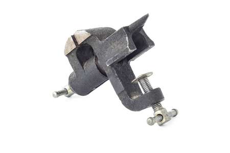 Small black desktop vise, close-up, isolate, vice-grip