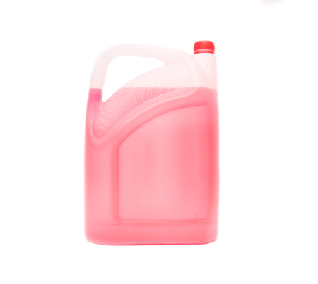 Canister with red antifreeze on a white background, isolate, coolant, close-up, nonfreezing, transparent, windscreen Stock Photo