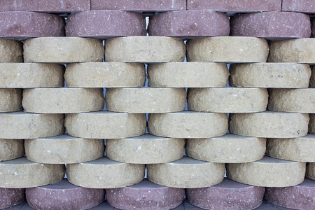 Brick wall from a round modern brick, background. Texture, construction Banco de Imagens