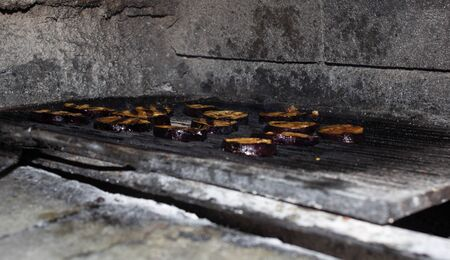 Eggplant slices are grilled in the oven, grilled vegetables, close-up, barbecue