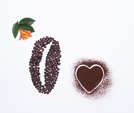 Coffee beans on a white background and an orange hibiscus flower, a heart of coffee, white background