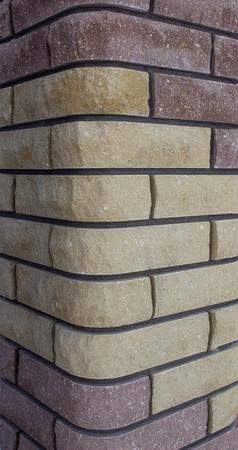 Modern brick column with brown and gray bricks, designer, texture, background, close-up Banco de Imagens