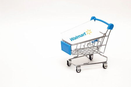 BOBRUISK, BELARUS - JANUARY 30, 2019: Shopping trolley on a white background online store, marketplace Walmart, symbol Editorial