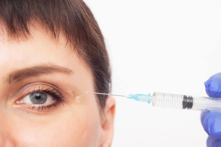 A cosmetologist injects a scar into a scar and a scar and uses hyaluronic acid for the resorption and healing of a scar, close-up, mesotherapy, steroids