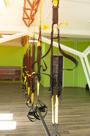 Modern fitness room for practicing hinges on the  for strengthening the muscular corset and burning calories, sport 写真素材