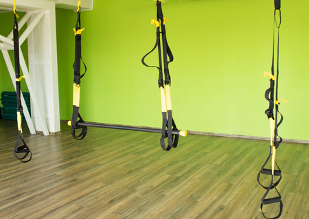 Modern fitness room for practicing hinges on the for strengthening the muscular corset and burning calories, sport