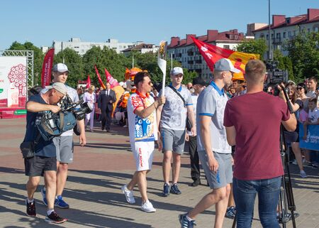 Bobruisk Belarus 06 03 2019: A man carries a torch with the Olympic flame at the European Games in 2019, celebration