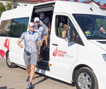 Bobruisk Belarus 06 03 2019: Male athletes carry the Olympic flame European Games 2019, europegames Redakční