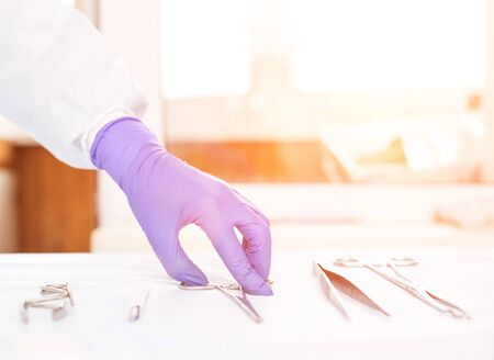 Doctor takes medical instruments from the table for the concept of transplantation of human organs and tissues, surgeons operating