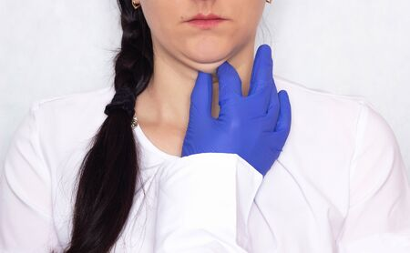 Doctor cosmetologist plastic surgeon holding a young girl for a double chin, problem, medical, portrait, health