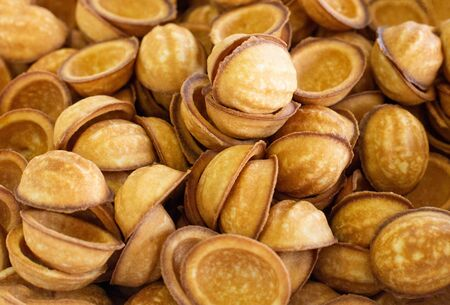 Background from the traditional dessert nuts with condensed milk, copy space, delicious