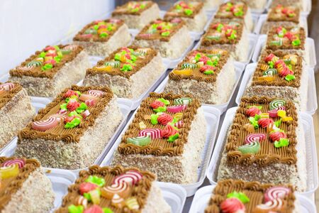 A lot of beautiful multi-colored cakes with marmalade. Cake Tale, copy space