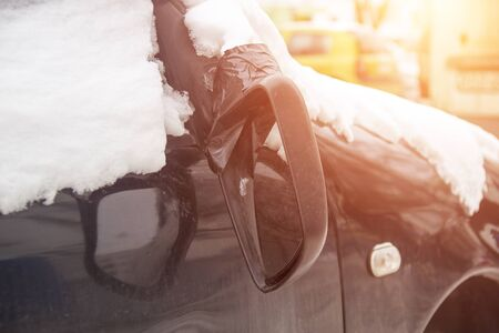 Broken car mirror on a car, concept of road accident and car insurance, winter, rearview mirror