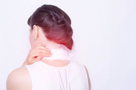 A girl with a medical compress on the neck, which has pain and inflammation of the neck muscles, treatment of diseases of the neck, vertebral instability
