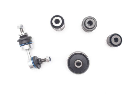 Set of silent blocks and stabilizer rod for car suspension on a white background, isolate