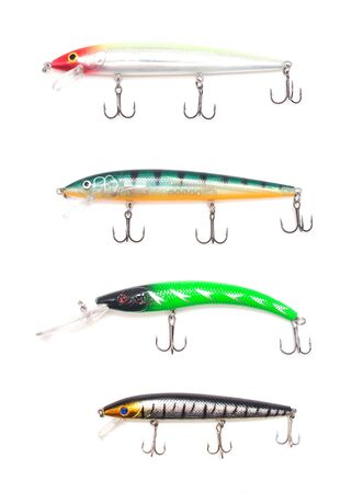 Multicolored lure baubles and wobblers for fishing on a white background, isolate, fishing gear, fishing tackle
