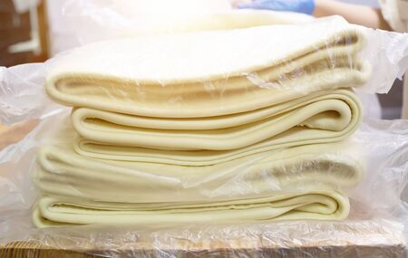 A lot of puff pastry in a baking factory for making puff pastries, production, manufacture