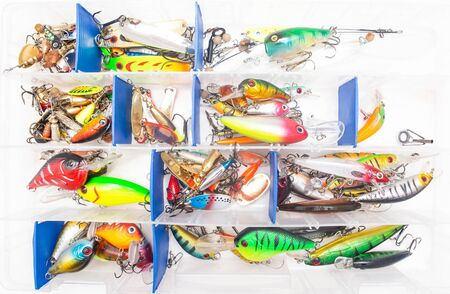 Fishing suitcase with multi-colored bait lure for fishing on a white background, wobbler, equipment Reklamní fotografie