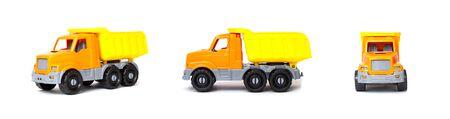 Small orange toy dump truck lorry on a white background, isolate, transportation 版權商用圖片