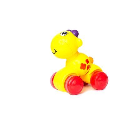 Childrens yellow toy giraffe on a white background, isolate, plastic 版權商用圖片