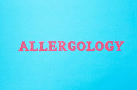 Inscription allergology in red letters on a blue background, section of the medicine. Science studying human allergens, concept of human allergic reactions, background, autoallergy