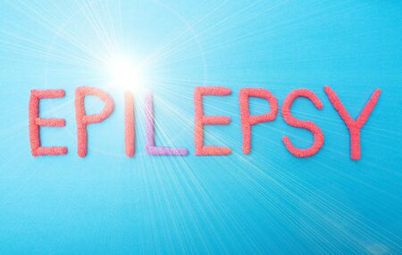 Word epilepsy in red letters on a blue background concept of epilepsy attacks, medicine, background