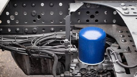 Coarse fuel filter of a truck. Diesel fuel cleaning in a truck, background 版權商用圖片