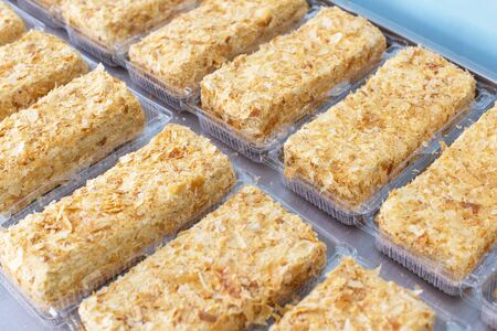 A lot of crispy fresh cakes Napoleon with condensed milk and puff pastry, background, torte, confectioner