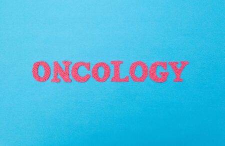 The word oncology on a blue background. The concept of diseases of benign and malignant tumors in humans. Cancer Medicine, medic