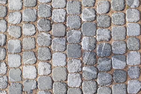Hermosa textura y fondo de baldosas cuadradas de pavimentación gris, espacio de copia, construcción