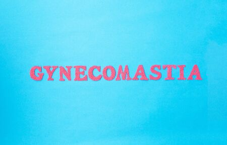 Gynecomastia word in red letters on a blue background. The concept of plastic surgery for adjusting male breasts, fatty