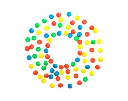 Multicolored children's mosaic on a white background in the form of a circle, copy space, ready to play