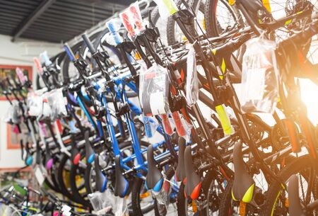 Selling sports bikes in the store. Healthy lifestyle concept, mountain and road bikes, background, transportation