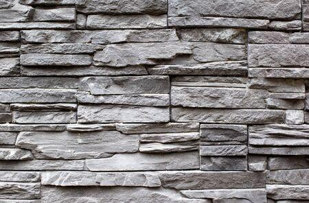 Textur und Hintergrund der grauen Steinmauer, moderne Gebäudedekoration Standard-Bild