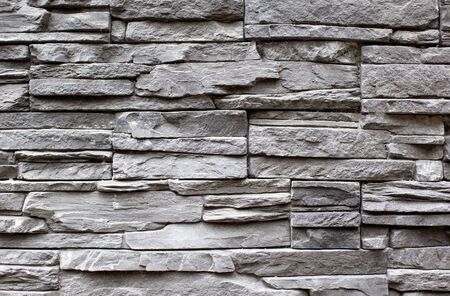 Texture and background of gray stone wall, modern building decoration Stockfoto