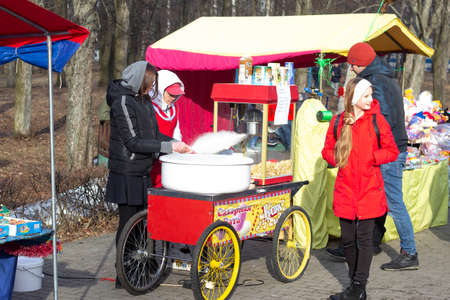 BOBRUISK, BELARUS 10.03.2019: Sale of cotton candy and popcorn for a holiday in the city Shrovetide, celebration