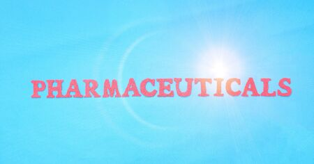 The word pharmaceuticals in red letters on a blue background. Concept of medicine section developing tablets and drugs for treating people.