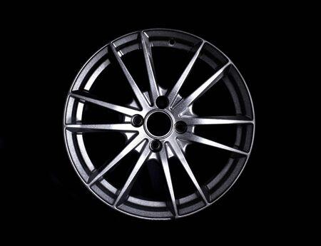 Modern automotive alloy wheel made of aluminum on a black background, industry. Designer fashion wheels for car, mechanic