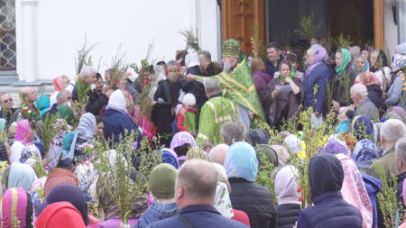 BOBRUISK, BELARUS - April 21, 2019: Church Christian holiday Palm Sunday, people go to church to light willow and willow branches, tradition, catholicism