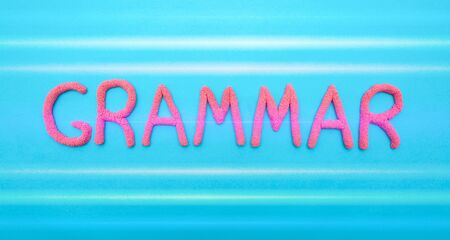 Grammar word in red letters on a blue background. Grammar and language learning concept
