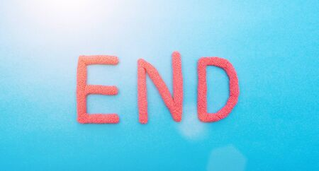 word end in red letters on a blue background