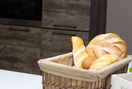 muffin lies in the kitchen in a small basket, loaves, bread and rolls. Bad food, fullness, copy space, homemade