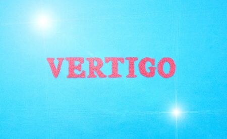 Word vertigo in red letters on a blue background. The concept of medical disease of weakness and dizziness 스톡 콘텐츠
